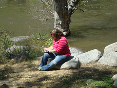 Small me writing by the river
