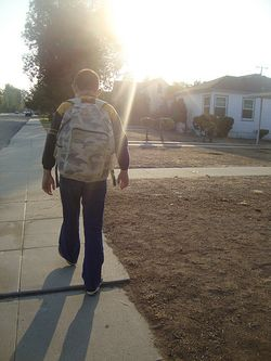 Samuel walking to school