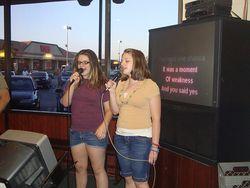 Girls sing karaoke