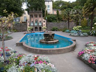 blue water fountain in stone garden, image copyright William Warby, flickr