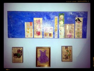 "This is how ""Neighbors"" looks on my wall. Below are other mixed media pieces, including the origami dress in the middle, which is another current them"