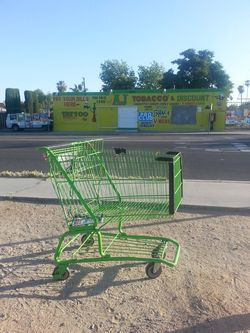 This Shopping Cart is art, indeed. This is a Dollar General Shopping Cart. I like how it looks near this particular tobacco and discount store.