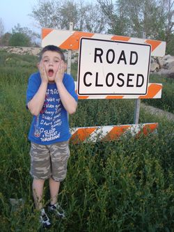 In the end, we all become stories - Samuel with the Road Closed sign