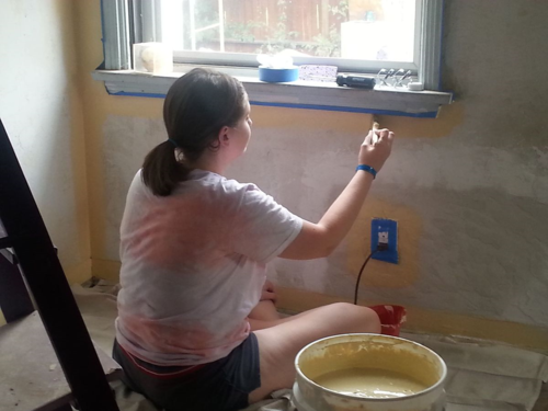 "Katherine, ""Cutting in"" the paint. By the way, we used recycled paint on the walls - zero cost to us and excellent for the environment. Does your community have a recycled paint center? Check into it -"
