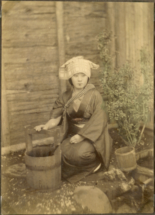 Japanese woman with a bucket
