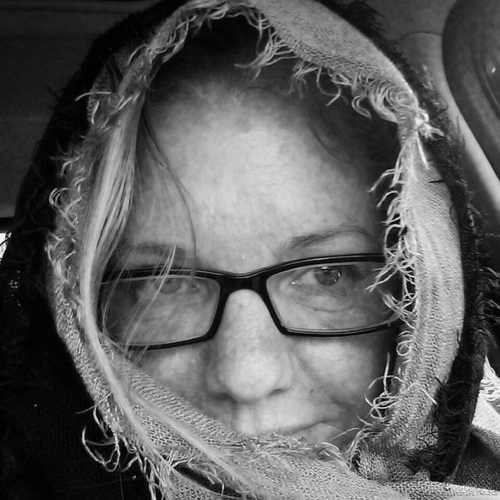 In today's 365 feminist selfie photo, I could see my splotchy skin. I am covering my worst area of rawness, my chin. What I see, though, is the hope in my eyes I hadn't known I had caught as I watched my daughter, Emma, cross the street.