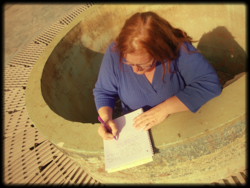 Julie Jordan Scott writes from inside a Fountain at Joaquin Murrietta Park in Oakland, California. Mr. Murrietta was one of Ina Coolbrith's closest writing friends.