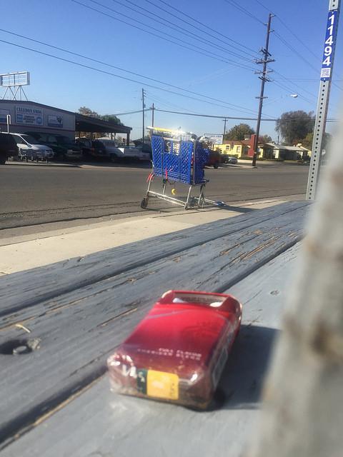 Shopping cart columbus alta vista cigs on bench