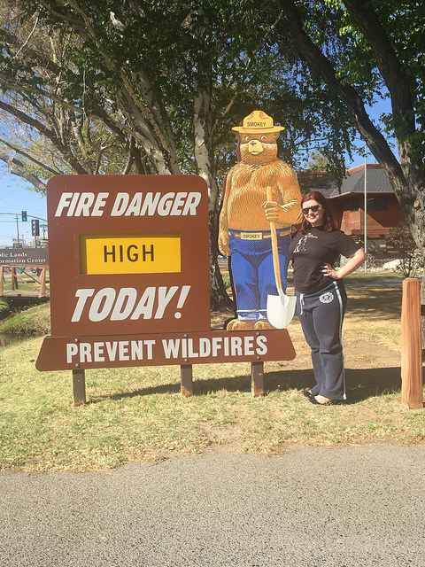 "This was the Smokey Bear Spring Break. Emma posed here with her ""new boyfriend"" - The signs are actually lots of fun - a lot of variety & different periods in Smokey Bear's life tell slightly different versions of the story. One truth? In our ongoing California Drought the fire danger is HIGH HIGH HIGH!"