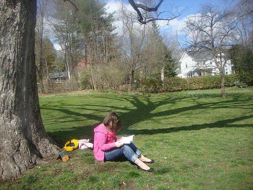 Emma reading at Emily's house